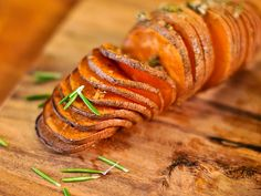 Grilled Hasselback Sweet Potatoes with Rosemary and Garlic from Serious Eats.