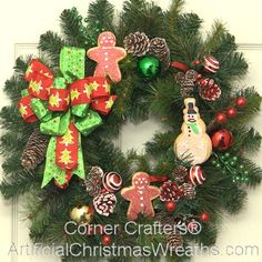 Gingerbread Man Accent Wreath - 2013 - A lovely Gingerbread Man Accent Wreath with colorful Christmas balls, pine cones, gingerbread men, and finished with a beautiful seasonal bow. Measuring app. 18 inches across. It is perfect for windows, doors, walls, as a lovely Christmas table centerpiece and more... #ChristmasWreaths #Wreaths #GingerbreadManWreaths #Gingerbreadman #SmallWreaths #AccentWreaths