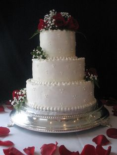 This cake was covered with buttercream icing with fresh red roses added