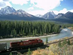 Canadian Rockies Railway, Canada  For sun-speckled lakes and virgin-white peaks, few landscapes are as famed as the Canadian Rockies, and what better way to discover the icy landscape than from the comfort of a plush, heated railway carriage? The Rockies – a UNESCO heritage site – provide a stunning backdrop of shale and limestone peaks as the railway winds through from Alberta to British Columbia.