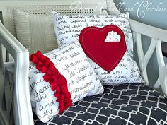 Love the ruffle one. Tutorial for adorable love note pillows.  It would also be cute to make them without the hearts with any type of verse or quote.  It is this type of thing that makes me want to learn how to sew!!!