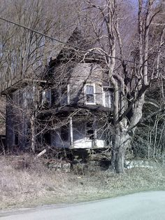 ~ Abandoned witches hat house in Guernsey County, Ohio.