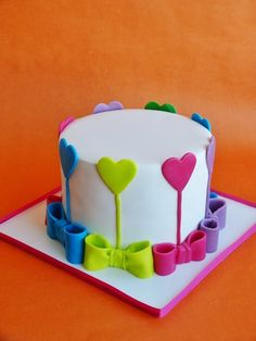 Bows and hearts, Colourful and pretty! Sweet #CakeDecorating We love!