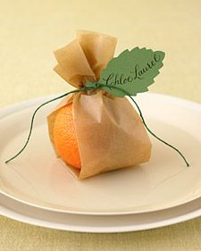 place card idea: Mini oranges (or apples or pears) in folded parchment paper