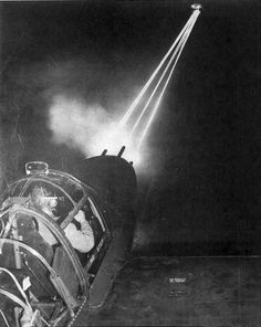 Nose guns of a P-38 Lightning aircraft lighting up the night sky as an armorer test-fired weapons after routine maintenance, date unknown