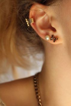 nice combination of two lobe piercings with an ear cuff
