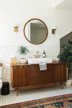 We're Obsessing Over This Modern Vintage Ohio Home bathroom vanity from an antique dresser #Moderninteriordesign