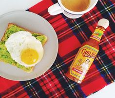 Tomorrow's Breakfast: Ingredients for a cozy morning breakfast: Avocado toast + coffee. Turn up the heat with hot sauce. Add tartan scarf/blanket thing. Repeat (we want to be here now).