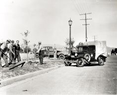 Tree planting on Reseda Boulevard, Fall, 1938. Carl S. Dentzel, a community leader, is visible at the center, wearing a suit. This photograph was taken between Parthenia Street and Roscoe Boulevard on Reseda Boulevard, east side of the street.  San Fernando Valley History Digital Library.