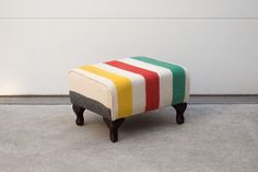 This custom Hudson Bay blanket ottoman would look great in the living room or at the farm.