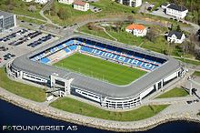 "Molde's current stadium is the Aker Stadion, formerly known as ""Molde Stadion"", located at Reknes, by the seashore of central Molde."