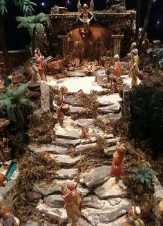 """Fontanini Christmas nativity display ideas. I've been a 5"""" scale collector for 33 years, and have thousands of pieces. It's our family Christmas tradition. Handmade stone steps leading up to the creche."""