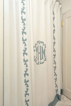 Custom shower curtain with applique monogram by Leontine