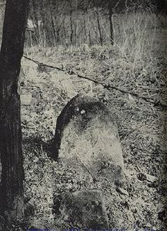 """""""Dornick"""" gravestone of Cal McCoy, killed by Hatfields at the time of the """"houseburning scrape."""" Dornicks are natural slabs of stone which are set up without aid of a professional stonecutter. This is only known grave of a McCoy victim in feud."""