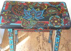 One of two hand painted saddle style wooden bar stools painted by sanctuary volunteer Stephanie Perciful.