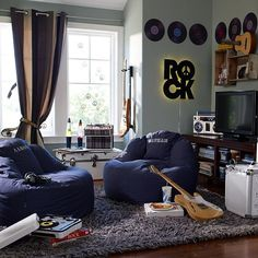I loved the article on teenage boys bedrooms and thought my son would love this one.  Blue grey gray rock music grunge style teenage boys bedroom