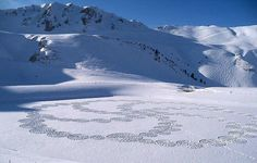 Snow Quilts by Simon Beck, along the frozen lakes of Savoie, France