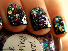 black + multi-colored glitter nails.