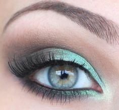 aqua/green eyeshadow, cat eye liner