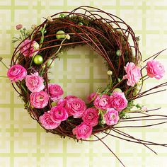 A simple moss-covered wreath form is dressed up for spring with a few redtwig dogwood stems, green ornament balls, and pink flowers: http://www.bhg.com/holidays/easter/decorating/easter-spring-door-decorations/?socsrc=bhgpin041014floweryspringwreath&page=16