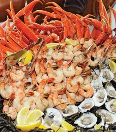 Seafood tower! Jumbo shrimp, marinated mussels, crab legs, and oysters on the half shell | Photo by Damon Tucci