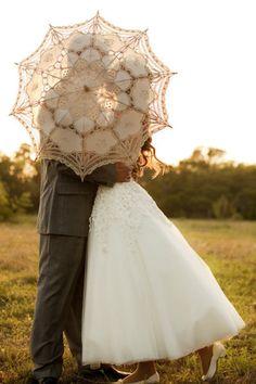 behind a parasol.