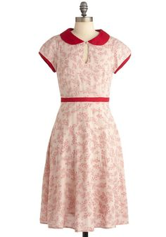 Such a pretty dress. I love the red trim.