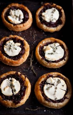 Red wine caramelized onions & goats cheese tartlets.