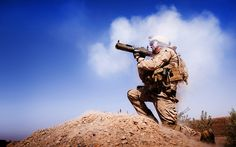 "Gunnery Sgt. Chris Denham, the company gunny for India Company, 3rd Battalion, 3rd Marine Regiment, watches as the rocket from his light anti-tank weapon closes in on a compound used by enemy fighters during a firefight in Trek Nawa, Afghanistan, while participating in Operation Mako, Sept. 21, 2010. ""The only thing louder than the back blast of the rocket was the Marines cheering,"" said Capt. Francisco X. Zavala, the India Company commander."
