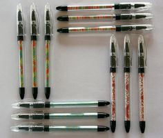 pretty up regular clear plastic pens with pretty paper.
