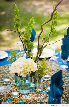 Pretty blue & green wedding centerpiece with branch accents.