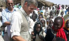 George Clooney on a visit to the Zamzam refugee camp in north Darfur in 2008. Photograph: Sherren Zorba/AP
