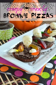 Creepy Crawly Brownie Pizzas - individual brownies topped with a cookie cream cheese topping and fun spooky candies   #halloween #brownies  http://www.insidebrucrewlife.com