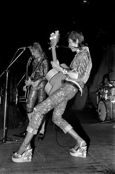 David Bowie and Mick Ronson on stage during the Ziggy Stardust tour, December 1972-January 1973.Bowie is wearing a pair of Platform Shoes decorated with palm trees by Pelican Footwear, New York~ Photo by Mick Rock ;))