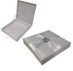 Luxury silk invitation. Box design with crystal embellishment and ribbon holder for your invites. Handmade in Thailand!