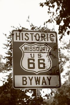 Route 66 Shield in Missouri. Overgrown road sign on Rt. 66.