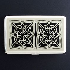 customizable cigarette cases, pill boxes, compact mirrors, keychains. kyle designs