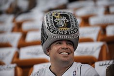 Miami Heat fan RJ Afanador, from Homestead, displays his Miami Heat championship ring hat before the Heat's first round playoff game.