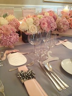 Couture pink and gray baby shower... gorgeous flowers, cute bib shaped menus