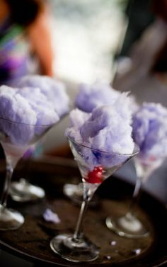 COTTON CANDY MARTINI with real cotton candy:   •1- 1/2 oz Pinnacle Cotton Candy Vodka   •1/2 oz X Rated Fusion Liquor   •1 oz  Cranberry juice (100% pure)   •A  handful of yummy cotton candy