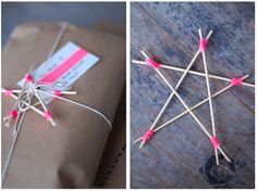 handmade stars made from toothpicks and neon twine.