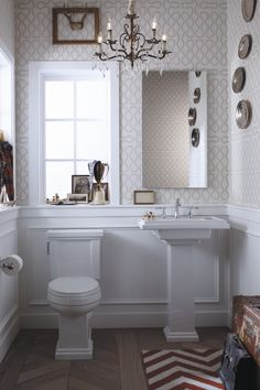 The strong architectural lines of the Shaker-inspired Tresham toilet and pedestal sink stand out in white.
