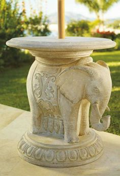 Our beautifully detailed Elephant Umbrella Table provides chair side shade and table service.
