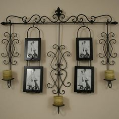 wall photo, dining rooms, wall hangings, candle holders, candles, sconc, decorative plates, wrought iron, picture frames