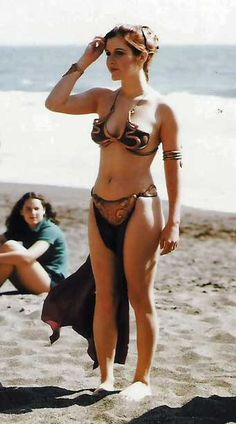 Carrie Fisher on the set of Star Wars in her Slave Leia outfit.