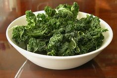 Kale chips: 1 bunch of kale, 1 tablespoon olive oil, 1/4 teaspoon salt approx 25 minutes at 250 degrees = actually really yummy