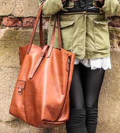 Absolutely gorgeous but will set you back $700. Dublin Leather Tote with extra long handles and a removable strap.