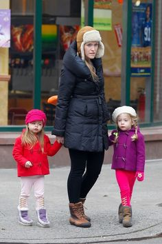 Sarah Jessica Parker's twin daughters Tabitha and Loretta Broderick wear colorful coats as they walk to school with their babysitter.