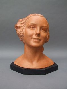 Female Bust by Demetre Chiparus   French terracotta bust of a beautiful lady, signed D. H. Chiparus in the clay