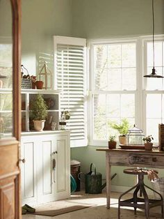 Barely-there walls in Behr's Topiary Tint reflect this mudroom's dual function as a potting room. | Photo: Courtesy of The Apron Blog/The Home Depot
